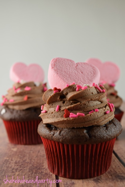 These rich Devil's Food cupcakes filled with Strawberry Fluff Cream are the perfect treat for your #Valentine!