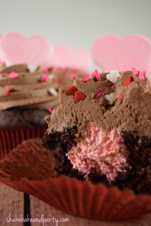 Devil's Food Cupcakes filled with creamy Strawberry Fluff filling!  Perfect for Valentine's Day!