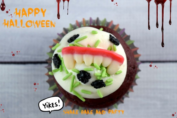 The cupcake that bites back!  Make these creepy fang #cupcakes for #halloween!